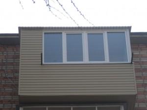 Наружная отделка балконов сайдингом